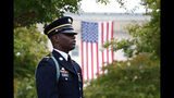 A member of the U.S. Army Old Guard stands on the grounds of the National 9/11 Pentagon Memorial before a ceremony in observance of the 18th anniversary of the September 11th attacks at the Pentagon. (AP Photo/Patrick Semansky)