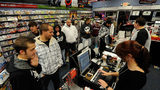 "Customers buy copies of ""Call of Duty: Black Ops"" at a GameStop store November 9, 2010 in North Las Vegas, Nevada. On Sept. 10, 2019, GameStop announced it would be closing at least 180 stores by the end of the year."