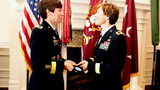 Maj. Gen. Maria Barrett presents her sister, Brig. Gen. Paula Lodi, a beret with a one-star insignia. The sisters became the first women siblings to attain the rank of general in the U.S. Army.