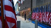 New York City firefighters stand at attention in front of a memorial next to One World Trade Center on Wednesday. Their ranks will soon be joined by children of fallen members of 9/11, who will be graduating from the FDNY academy.