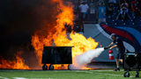 A failed pyrotechnic device bursts into flames Sunday before the game between the Tennessee Titans and the Indianapolis Colts at Nissan Stadium.