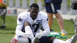 New England Patriots wide receiver Antonio Brown ties his shoe during an NFL football practice, Wednesday, Sept. 18, 2019, in Foxborough, Mass.