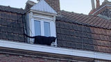 A panther walks on the roof of a building in Armentieres, in northern France, Wednesday Sept.18, 2019, after escaping its home. Investigators are trying to locate the owner. Police said the cat was friendly and had obviously been raised by humans.