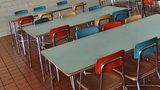 Stock photo of a school cafeteria.