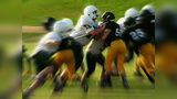 High school football players at a game. A bill under consideration in Ohio would make assaulting a sports official a felony. The bill comes after an increase in attacks on referees at youth sporting events.