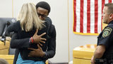 Murder victim Botham Jean's younger brother, Brandt Jean, hugs Amber Guyger, the former Dallas police officer who killed his brother, after delivering his impact statement Wednesday, Oct. 2, 2019, in Dallas. Guyger, 31, was sentenced to 10 years.