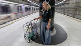 In this Monday, Sept. 30, 2019, photo, Emily Zamourka who is homeless sings at the Wilshire-Normandie station in Los Angeles. Zamourka, whose angelic singing in a Los Angeles subway was captured on video is being offered praise and help.