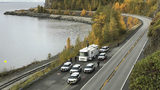 An Oct. 2, 2019, photo shows police at the scene where human remains were found along Seward Highway in Anchorage, Alaska. Brian Steven Smith, 48, of Anchorage, was charged Monday, Oct. 7, 2019, with murder after being connected to the case.