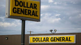 Dollar General store signs.  An armed clerk at a Dayton store shot and killed a would-be robber while customers shopped in the store, police said