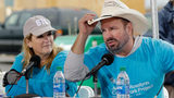 Country music stars Garth Brooks and Trisha Yearwood speak during a news conference at a Habitat for Humanity building project Monday, Oct. 7, 2019, in Nashville, Tenn.
