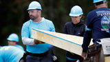 Country music star Garth Brooks, left, works at a Habitat for Humanity building project Monday, Oct. 7, 2019, in Nashville, Tenn.