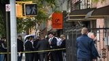 Police investigators were on the scene of a shooting near a Brooklyn social club early Saturday.
