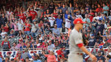 Despite the Braves' front office not promoting the tomahawk chop in Game 5, fans did it anyway before St. Louis Cardinals starting pitcher Jack Flaherty, right, delivered a pitch in the fourth inning.