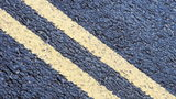 A road crew in Utah painted a double yellow line over a dead raccoon on a county road last week.
