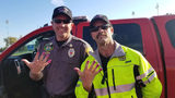 North Davis Fire Battalion Chief Allen Hadley, left, and Capt. Kevin Lloyd show off their manicures Saturday, Oct. 12, 2019, at the scene of a crash in Clearfield, Utah, where they calmed a scared young girl by letting her paint their nails.