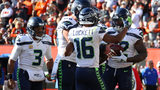 Chris Carson #32 of the Seattle Seahawks celebrates his fourth quarter touchdown with Tyler Lockett #16, Justin Britt #68 and Russell Wilson #3 while playing the Cleveland Browns at FirstEnergy Stadium on October 13, 2019 in Cleveland.