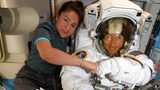 In this image released Friday, Oct. 4, 2019, by NASA, astronauts Christina Koch, right, and, Jessica Meir pose for a photo on the International Space Station.