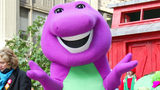 Barney the dinosaur rides on a float at the 76th Annual Macy's Thanksgiving Day Parade in Herald Square on Nov. 28, 2002, in New York City.