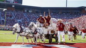 The Sooner Schooner makes a run following a Sooner touchdown in the second quarter against West Virginia on Saturday. The iconic Schooner tipped over after a TD, but no one was hurt.