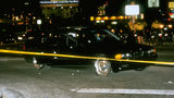 The bullet-riddled BMW in which rapper Tupac Shakur was fatally shot is pictured behind crime scene tape Sept. 7, 1996, at the scene in Las Vegas. Shakur, 25, died six days later, on Sept. 13, from his wounds. His killing has never been solved.