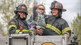 Olivia Gant waves from atop a fire truck in an April 2017 photo. The girl's mother, Kelly Turner, is accused of murder, fraud and other charges in her Aug. 20, 2017, death. Authorities say Turner, 41, lied about her daughter being terminally ill.