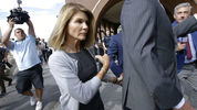 FILE PHOTO: Lori Loughlin, her fashion designer husband, Mossimo Giannulli, and nine other parents face new charges in the college admissions scandal.
