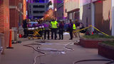2 dead after vehicle plunges 4 stories from Indianapolis parking garage