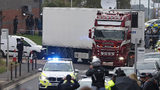 Police escort the truck, that was found to contain a large number of dead bodies, as they move it from an industrial estate in Thurrock, south England, Wednesday, Oct. 23, 2019.