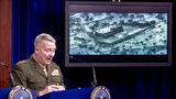 Gen. Frank McKenzie shows photographs and videos during a news conference as he describes the raid that killed Islamic State leader Abu Bakr al-Baghdadi.