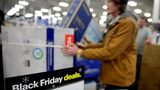 In this Nov. 22, 2018, file photo people wait in line to buy televisions as they shop during an early Black Friday sale at a Best Buy store on Thanksgiving Day in Overland Park, Kansas. AP Photo/Charlie Riedel