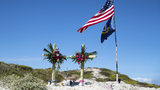 Adam Curtis Williams, 33, of Utah, is wanted in connection with the killings of a New Hampshire couple found buried on a Texas beach Sunday, Oct. 27, 2019. A makeshift memorial for James and Michelle Butler is seen on Padre Island Monday, Nov. 4.