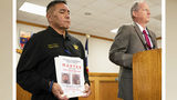 Kleberg County Chief Deputy Jaime Garza, left, listens as Sheriff Richard Kirkpatrick speaks Tuesday, Nov. 5, 2019, about a man sought in the deaths of James and Michelle Butler, who were found buried on a Padre Island, Texas, beach last month.