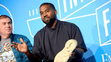 """Steven Smith and Kanye West speak on stage at the """"Kanye West and Steven Smith in Conversation with Mark Wilson"""" at the on November 07, 2019 in New York City."""