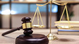 Stock photo of scales and a gavel.