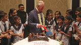 Britain's Prince Charles, center, celebrates his birthday with school children at Taj Mahal Palace hotel in Mumbai, India, on Nov. 14, 2019.