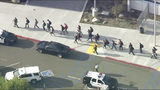 People are lead out of Saugus High School after reports of a shooting on Thursday, Nov. 14, 2019 in Santa Clarita, California.