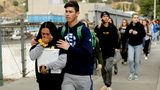 Students are escorted out of Saugus High School after reports of a shooting on Thursday, Nov. 14, 2019, in Santa Clarita, Calif. AP Photo/Marcio Jose Sanchez