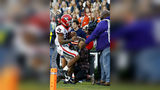 Georgia running back Brian Herrien (35) runs out of bounds and into a photographer during the first half of an NCAA college football game against Auburn, Saturday, Nov. 16, 2019, in Auburn, Ala.