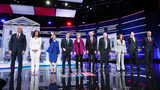 Democratic presidential candidates arrive on stage before the start of the Democratic presidential debate at Tyler Perry Studios on November 20, 2019, in Atlanta.