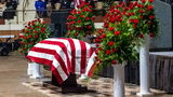 "The casket of slain sheriff John ""Big John Williams"" was draped in an American flag during Monday's service in Montgomery, Alabama."