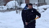 Albany police stepped in Monday to help clear snow from a 99-year-old woman's home.