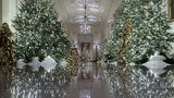 The Cross Hall leading into the State Dining Room is decorated during the 2019 Christmas preview at the White House, Monday, Dec. 2, 2019, in Washington. (AP Photo/Alex Brandon)