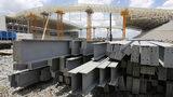 In this Dec. 8, 2013 file photo, steel beams sit outside Arena de Sao Paulo in Sao Paulo, Brazil.