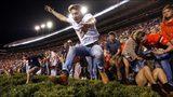 Auburn fined $250K after fans storm field